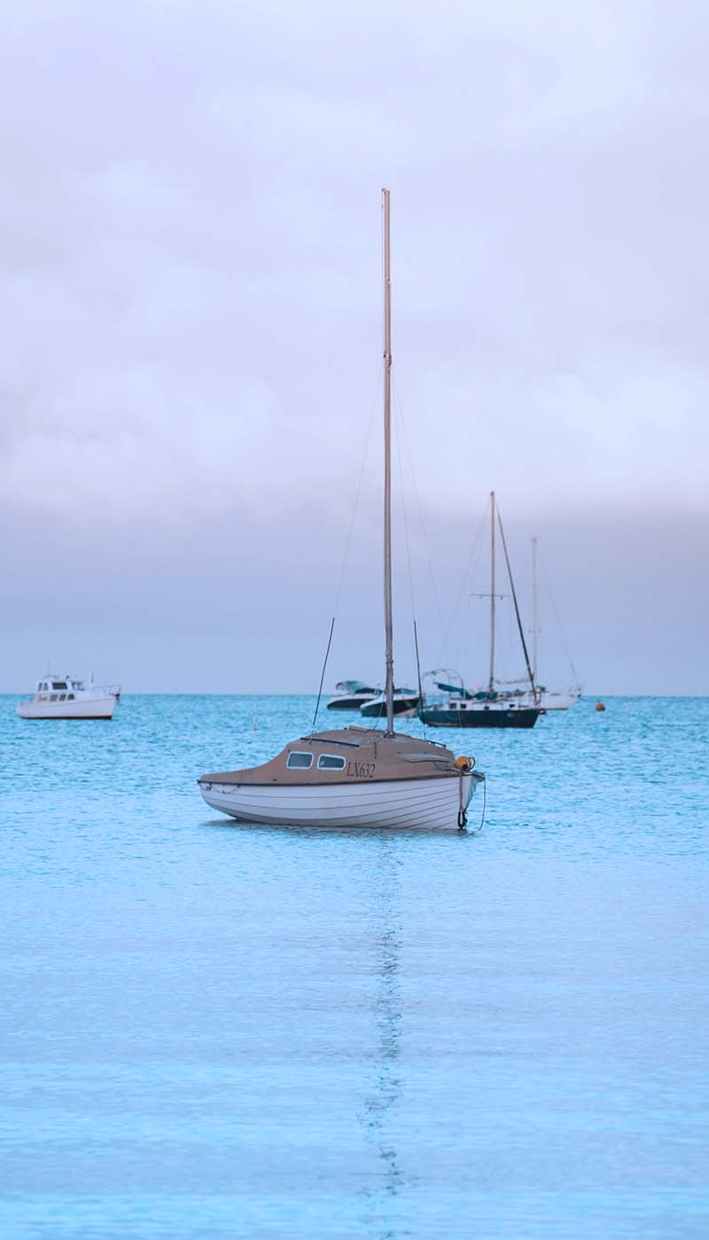 View of an airplane wing and clouds taken from inside the plane