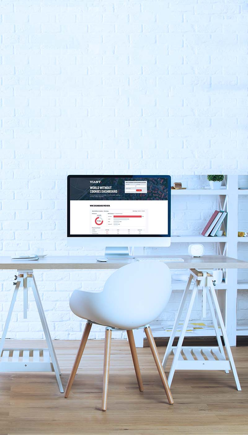 Desk top with laptops and a professional taking notes with a pencil and paper